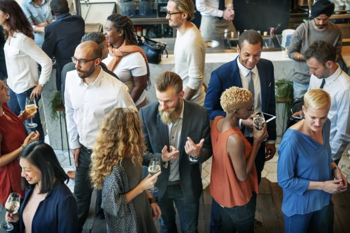 Business people mingling at a party
