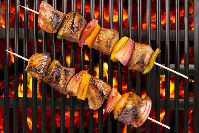 meat skewers on a grill