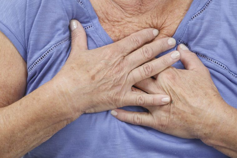 Woman with hands on chest