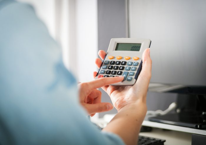 person using a handheld calculator