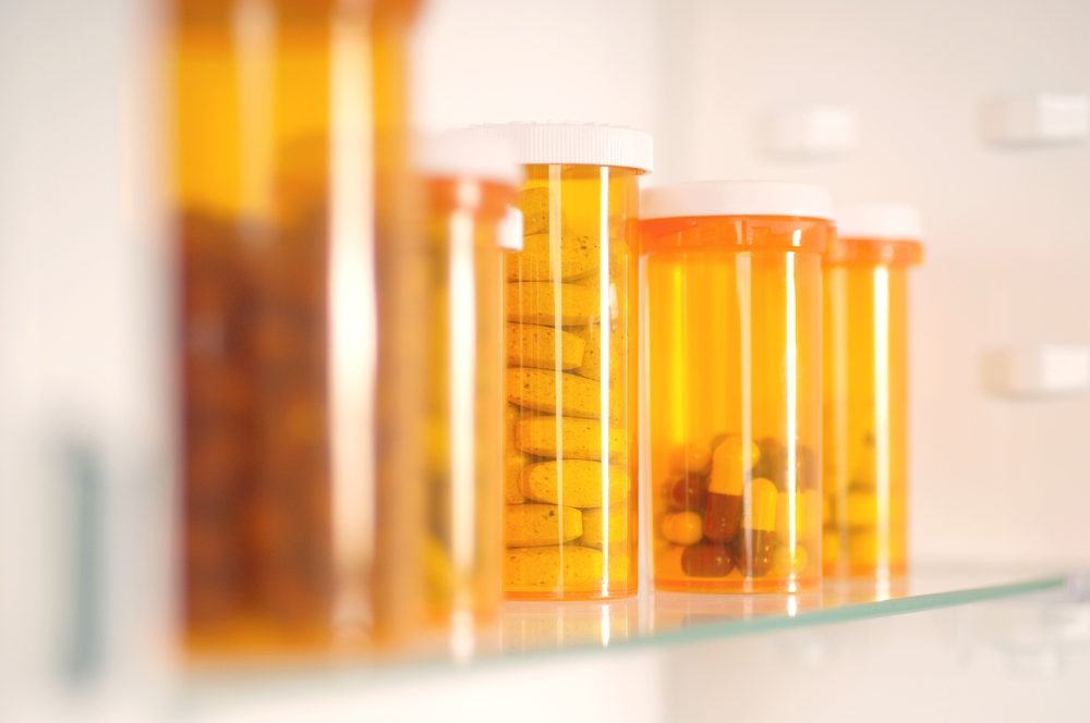 Bottles of pills in cabinet
