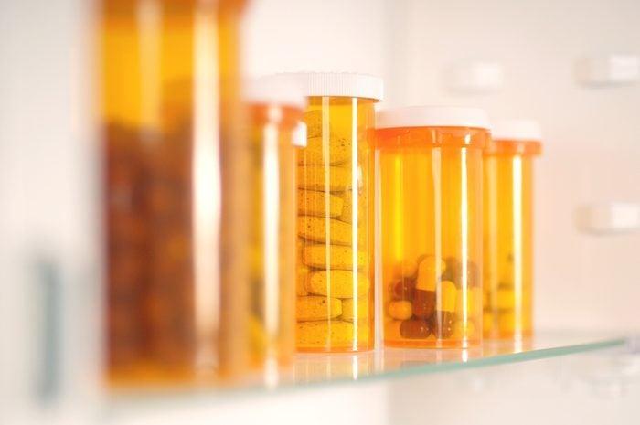 Bottles of pills in cabinet