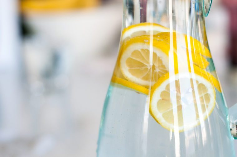 Yellow lemon slices in a clear bottle of water