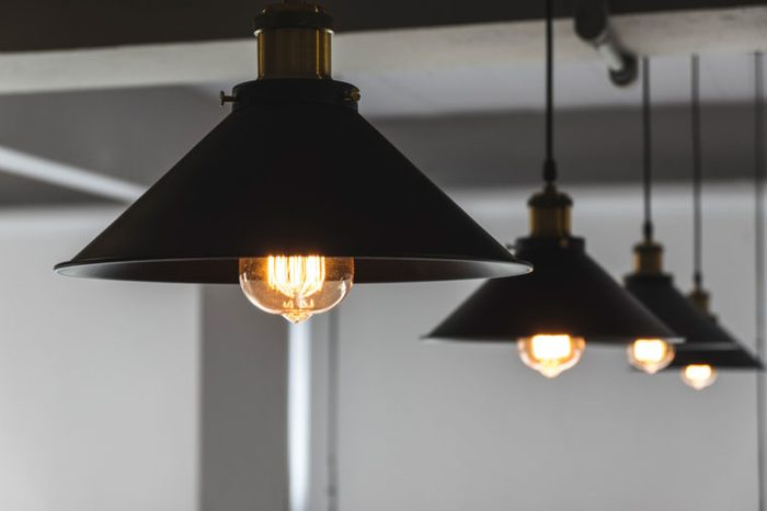 A group of hanging pendant lights showing low light