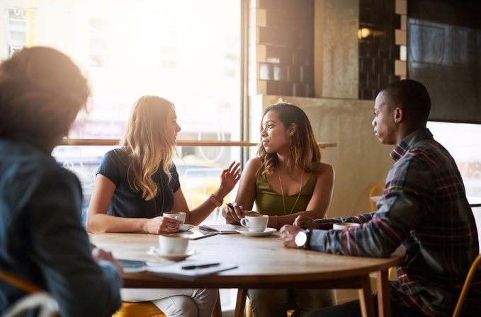 friends hanging out and chatting at a cafe