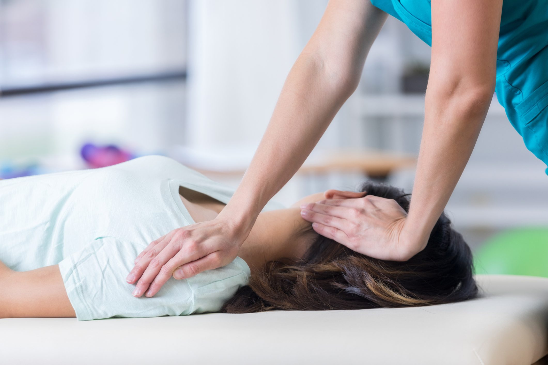 cropped shot of chiropractor adjusting patient