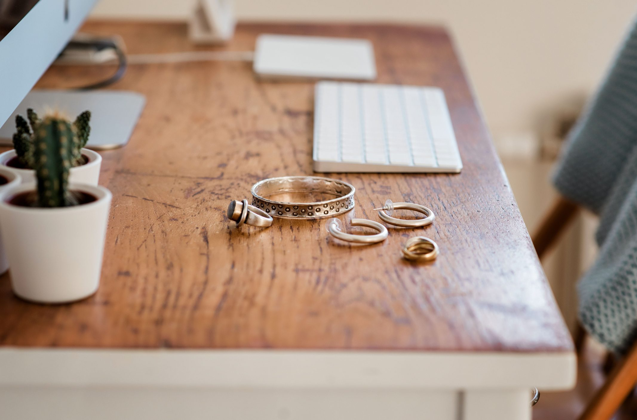 jewelry on wooden desk