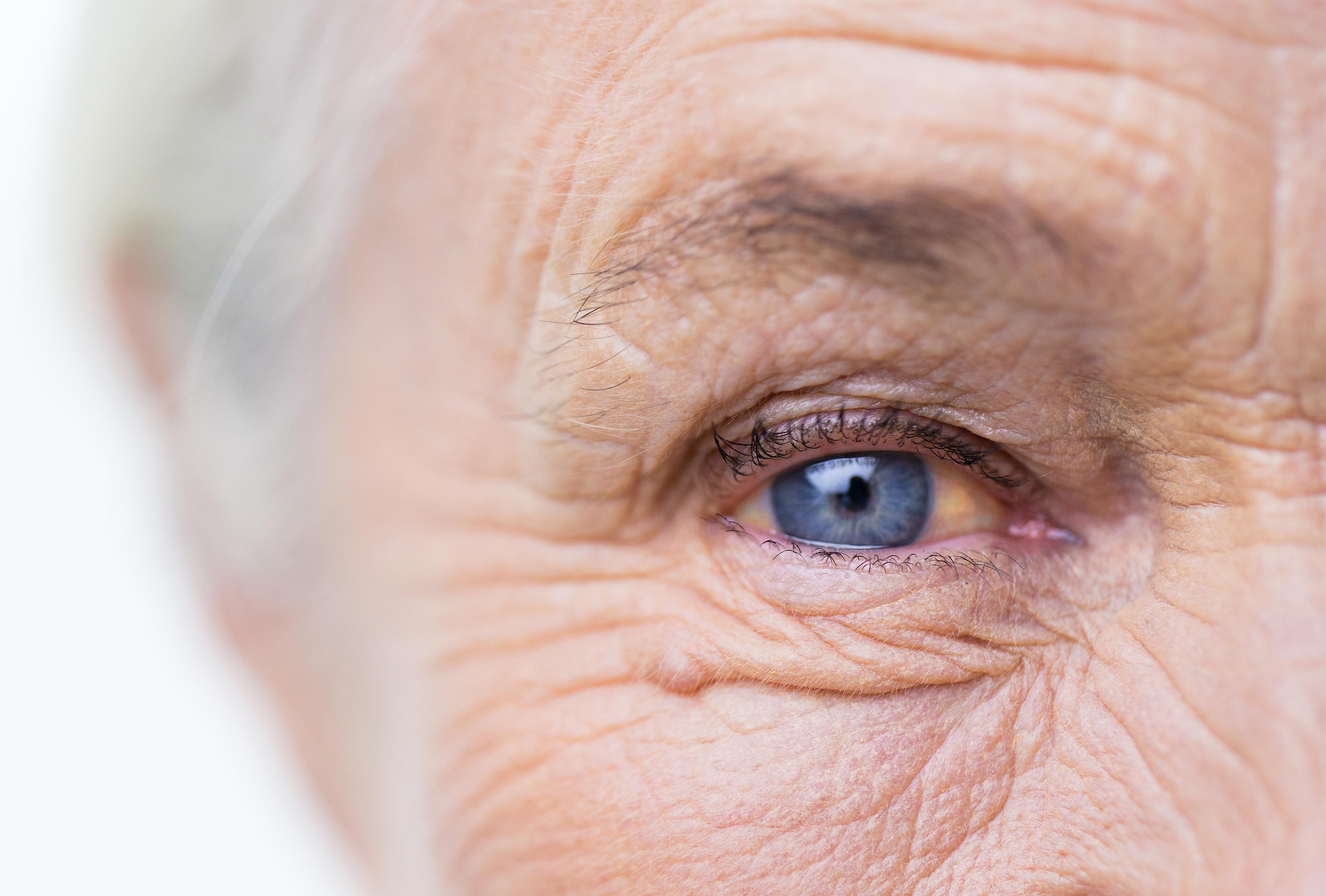 older woman blue eye closeup