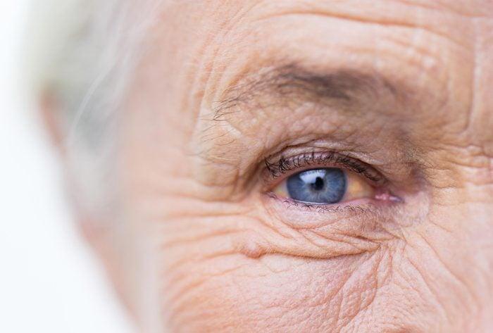 older woman blue eye closeup