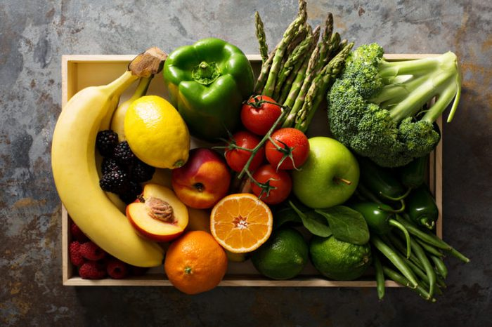 wooden crate full of fresh vegetables and fruit