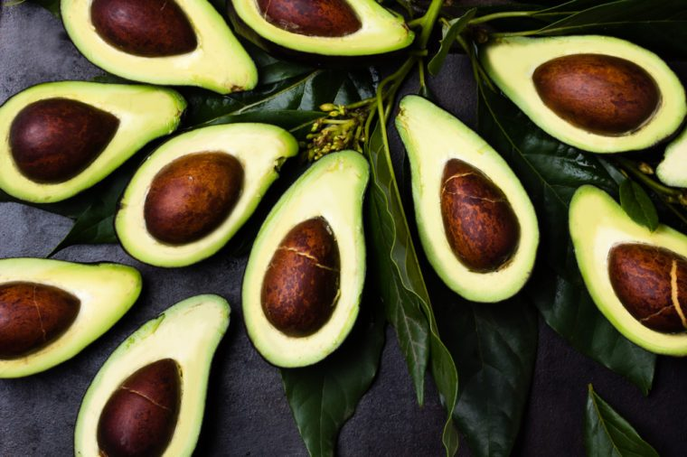 avocado halves with pits