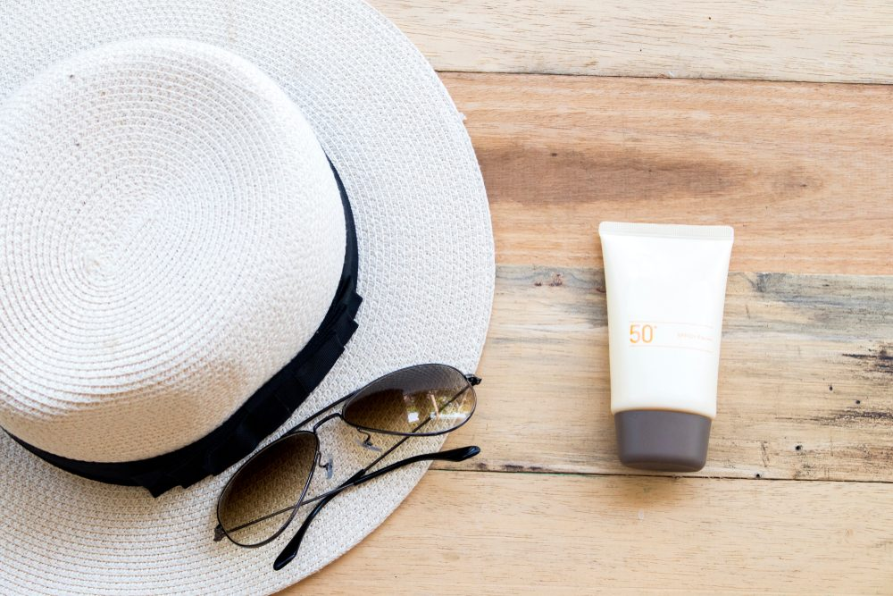 straw hat, sunscreen, and sunglasses