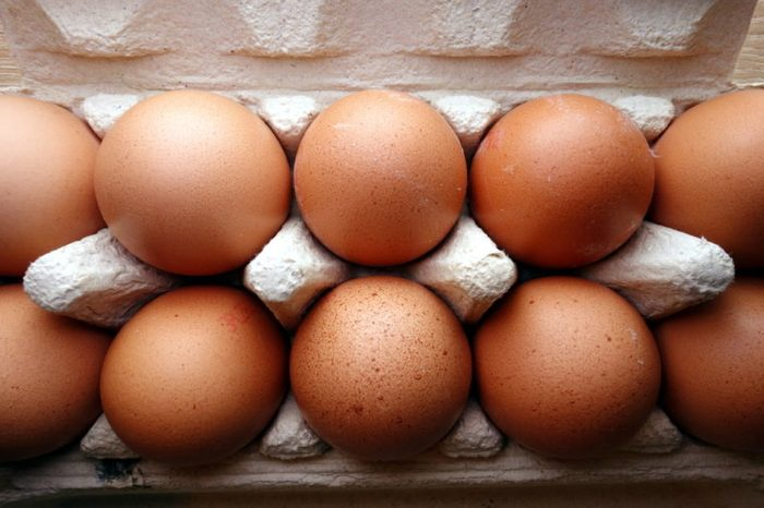 Organic eggs in a box, overhead view