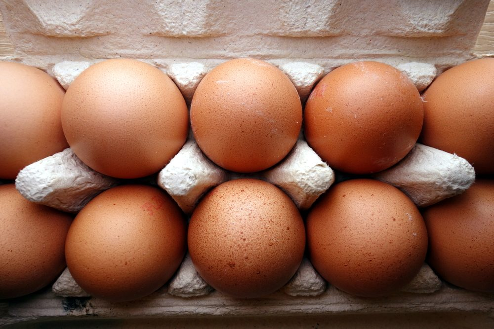 Organic eggs in a cardboard carton