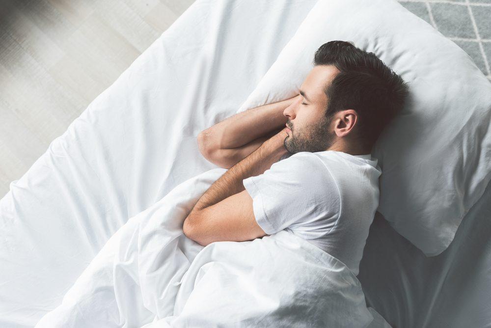 man sleeping in bed
