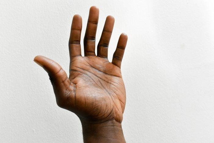 man's hand against white background