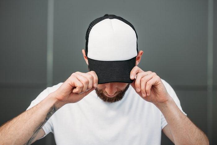 man wearing baseball cap