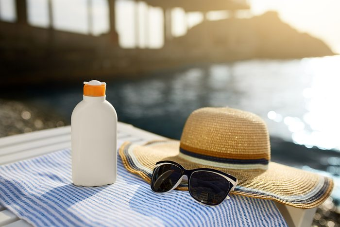 sunscreen, hat and sunglasses