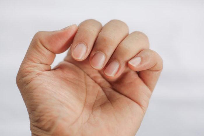 Closeup of a man's finger nails.