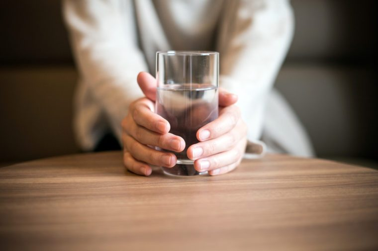 Woman holding a glass of the water.