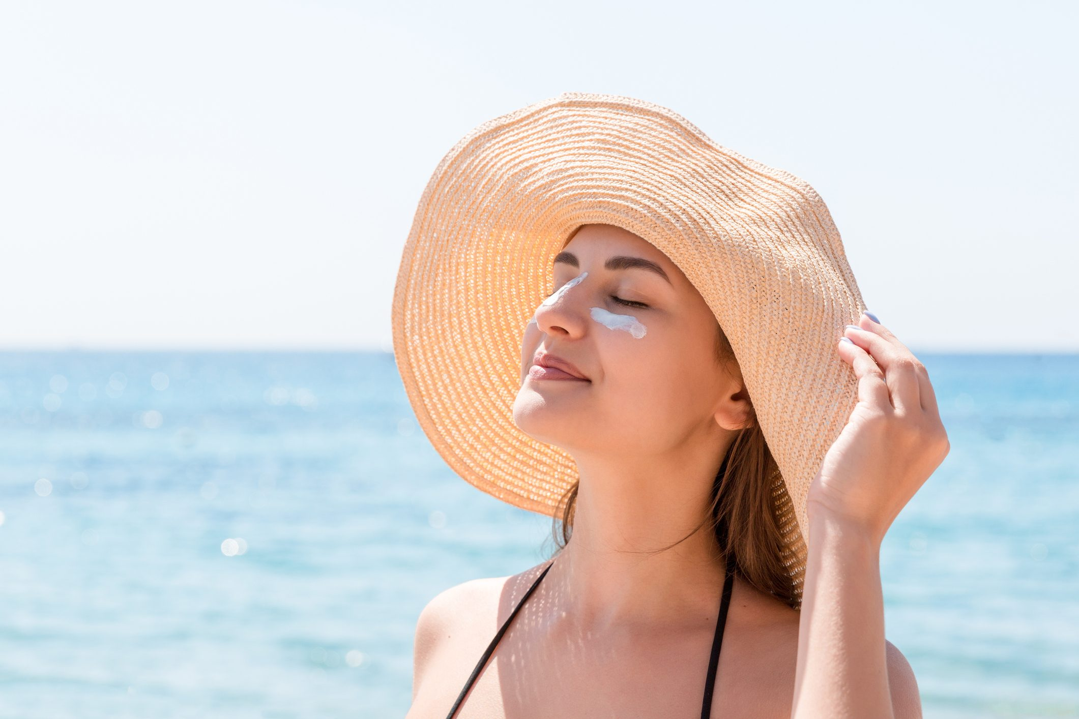 woman in sun hat at the beach