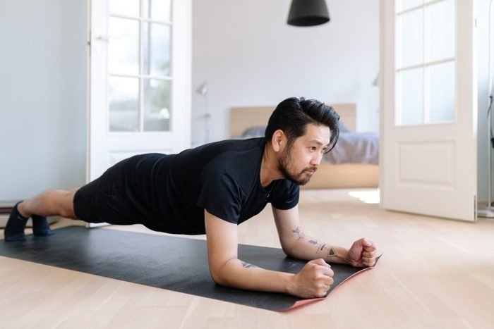 man in plank position exercising at home