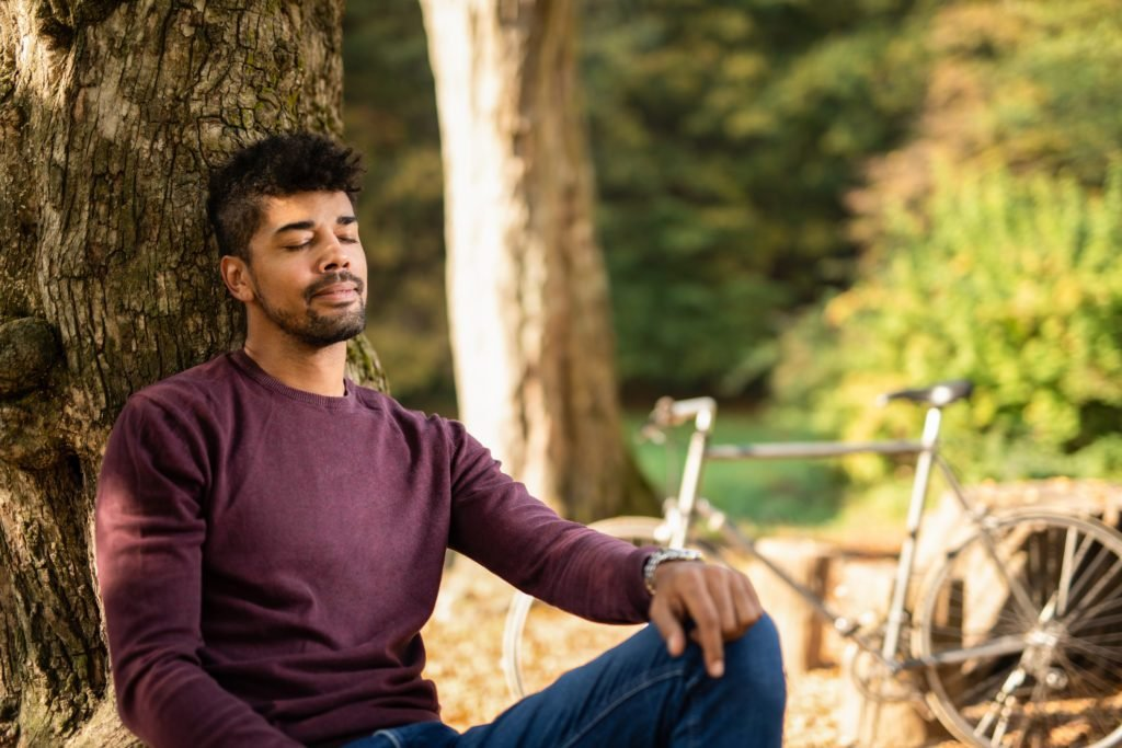 man sitting outside relaxing
