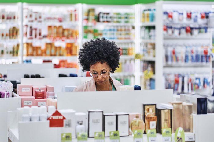 female customer shopping in drug store