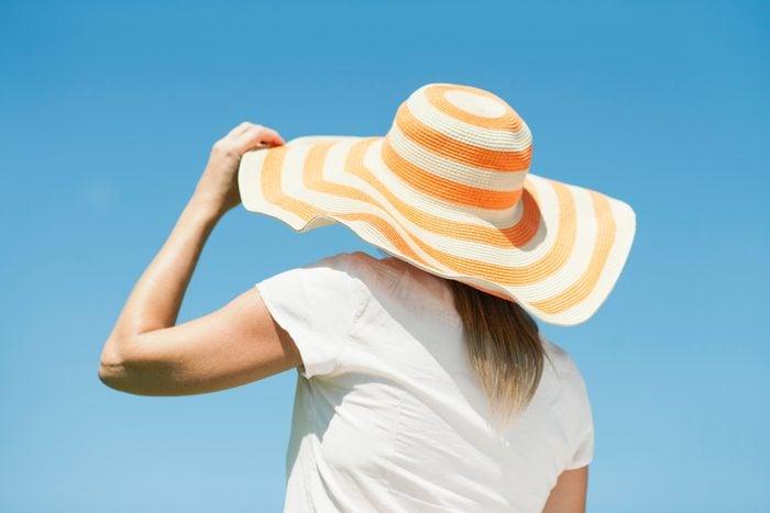 rear view of woman wearing sun hat