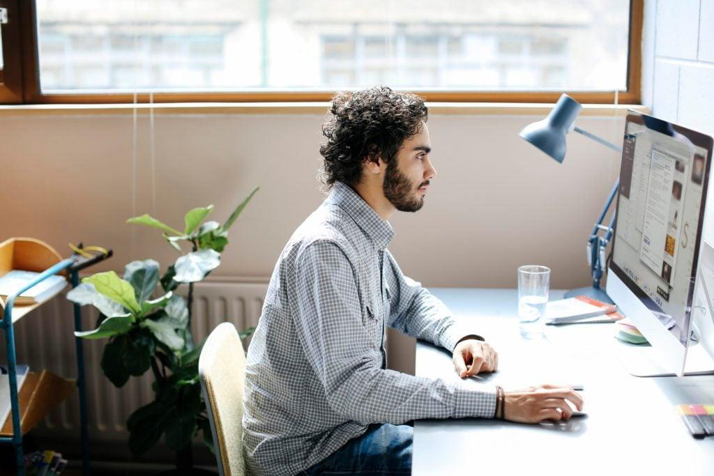 man sitting at desk working