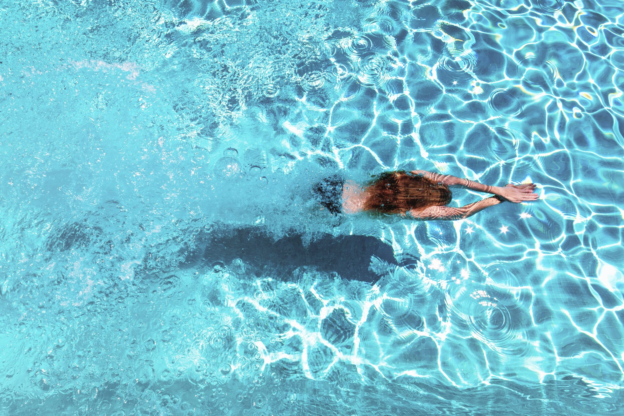 overhead shot of woman swimming in pool