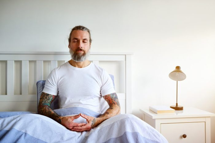 man in bed during the morning