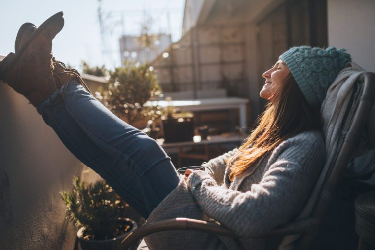 young woman sitting outside enjoying fresh air