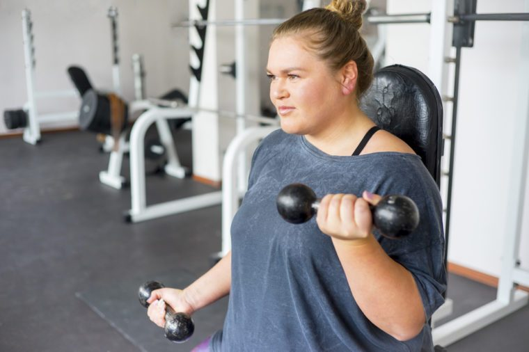 Overweight girl in a gym