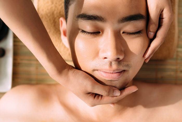 Close-up of man enjoying professional facial massage