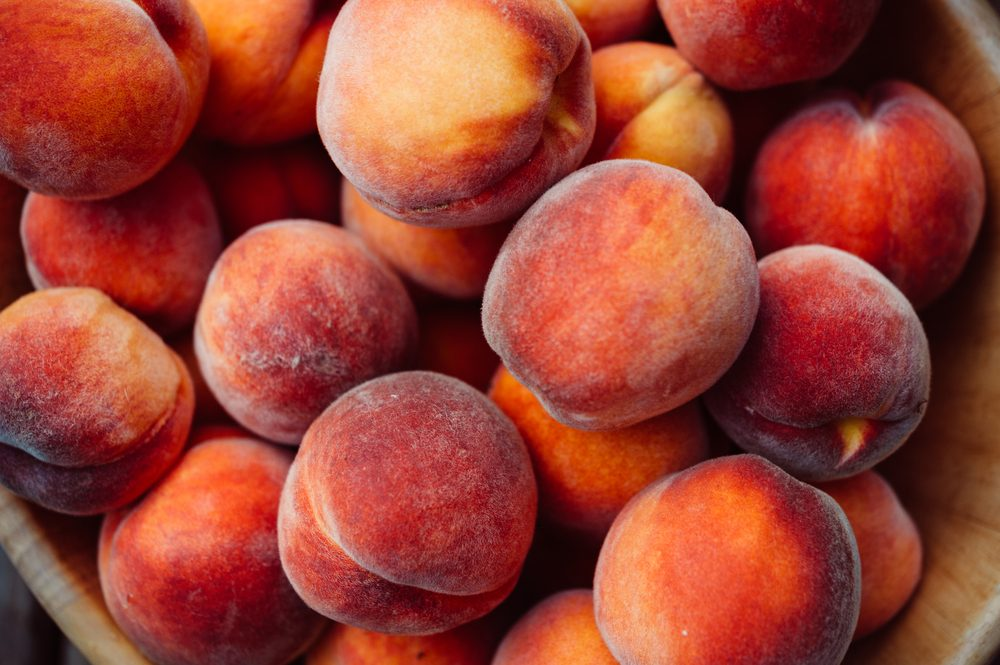 basket of ripe peaches