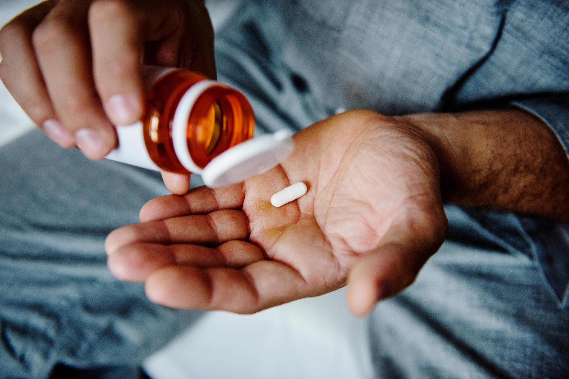 capsule in man's hand