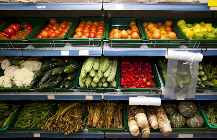 Various vegetables on shelves in grocery store