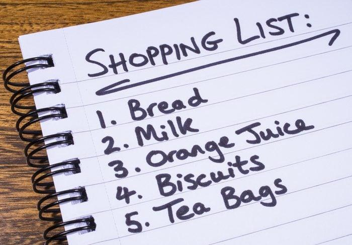 A shopping list written in a notepad.