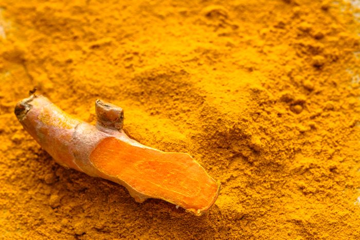 Fresh root and turmeric powder, indian spice, healthy seasoning ingredient for vegan cuisine