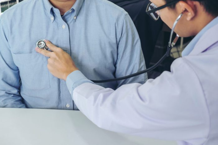 Close up of doctor listening to patient heartbeat with stethoscope on hospital, Physical examination, Medical and health care concept.