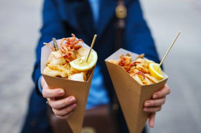Italian street food grilled seafood fish, shrimps, calamari and vegetables