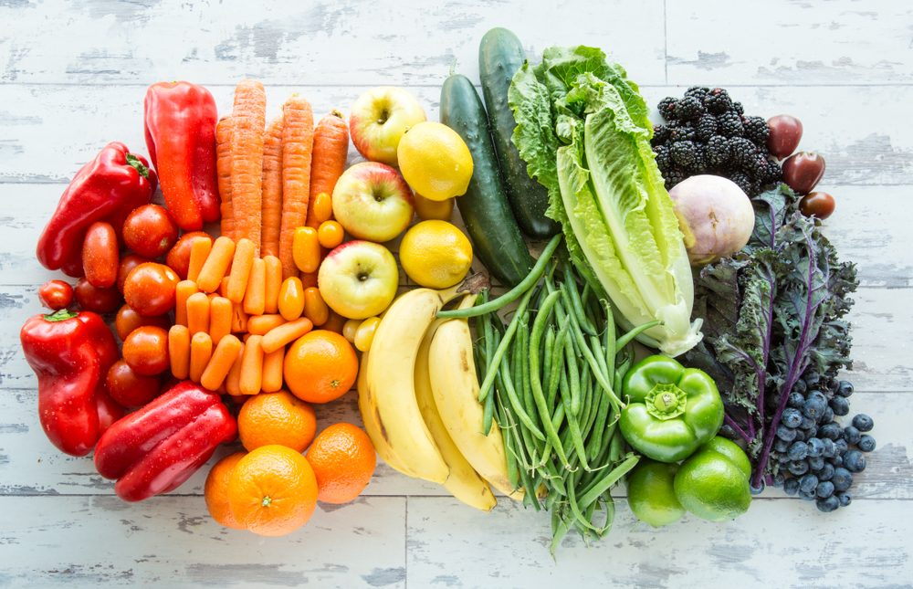 Variety of fresh fruits and vegetables sorted by colors to Eat each day