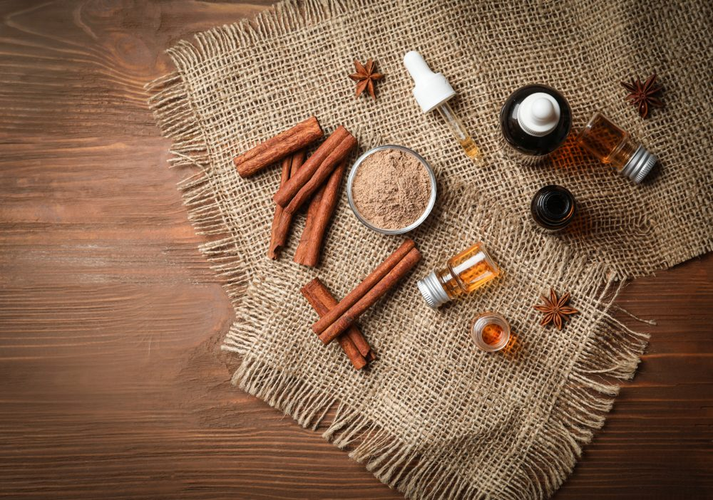 cinnamon sticks and bottles of cinnamon