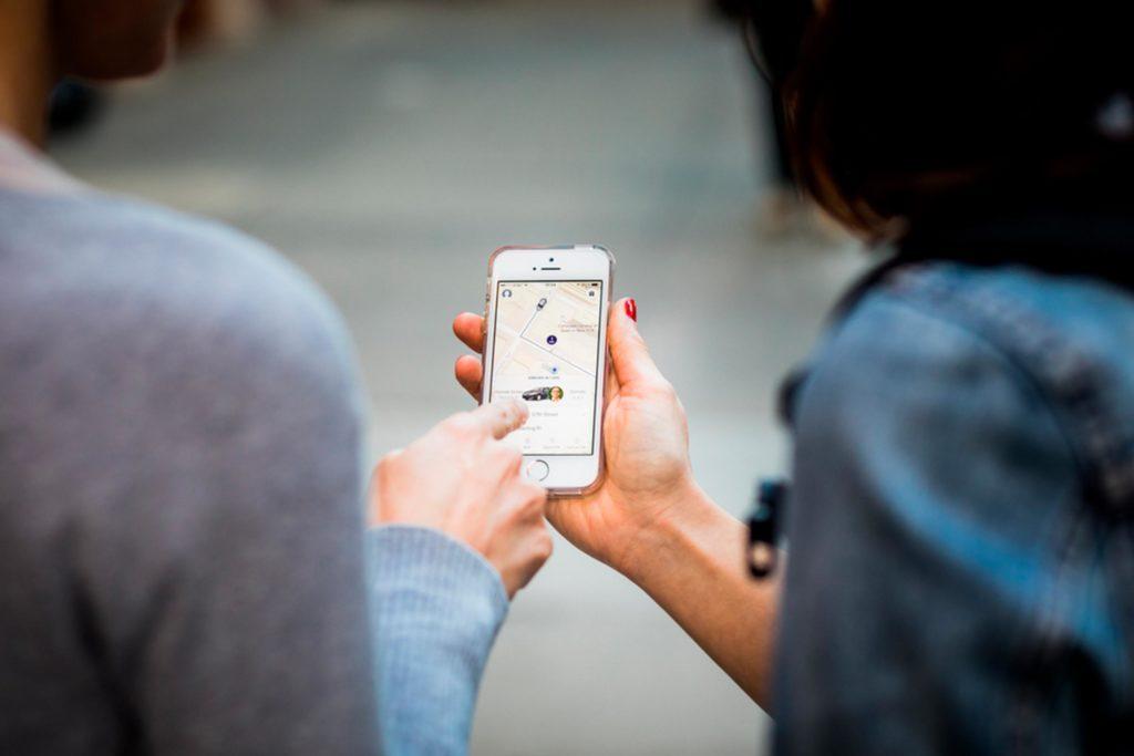 man and woman looking at phone
