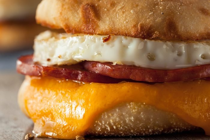 Homemade Breakfast Egg Sandwich with Cheese on an English Muffin
