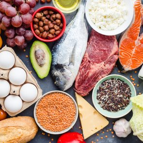 Healthy nutrition concept. Balanced healthy diet food. Meat, fish, vegetables, fruit, beans, dairy products. Top view. Cooking raw ingredients. Organic food. Clear eating. Healthy food idea. Overhead