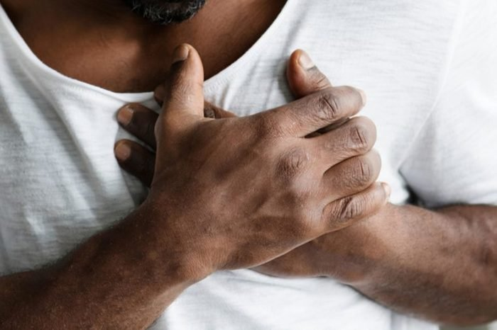 close up of man clutching his chest