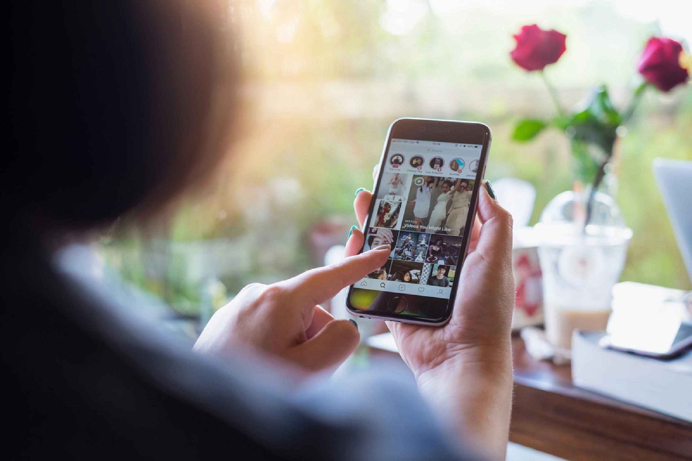 A woman hand holding iphone with login screen of instagram application. Instagram is largest and most popular photograph social networking.