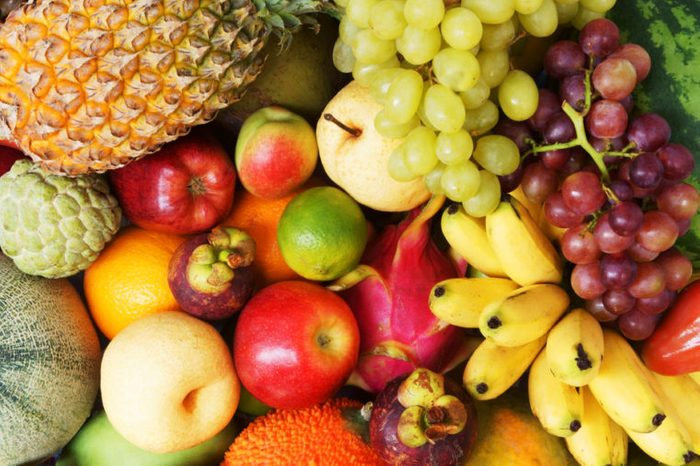 Fruit background, many fresh fruits mixed together